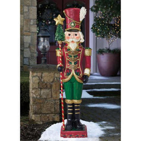 As if straight from the north woods this charming carved style Nutcracker will bring the warmth of the holiday season into your home. At 6 feet tall, he stands at attention, bearing a beautiful miniature Christmas tree on his staff. Elegant and playful at the same time, the toy soldier styling is the perfect touch.