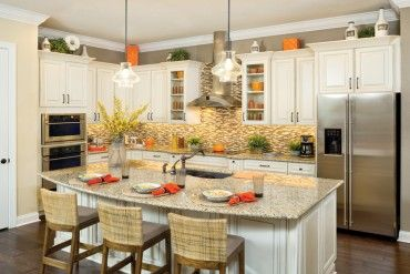KAI Open Kitchen Layout Large Island White Cabinets Stainless Steel Appliances