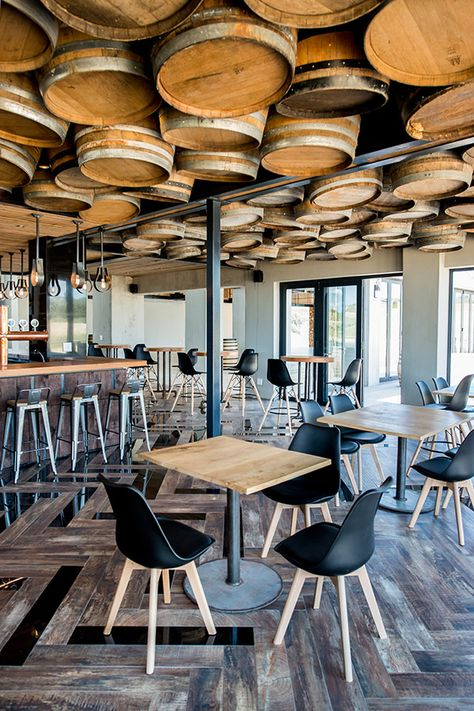 Inhouse Brand Architects executes a modern design for Anura Vineyards' new events venue and bar.