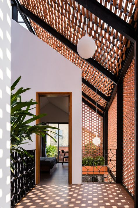 vietnam house architecture block architects encloses three-part house in vietnam with patterned brick shell Nook Architects, Tamizo Architects, Zaha Hadid Architects, Famous Architects, Architects Quotes, Architecture Design, Tropical Architecture, Facade Design, Landscape Architecture
