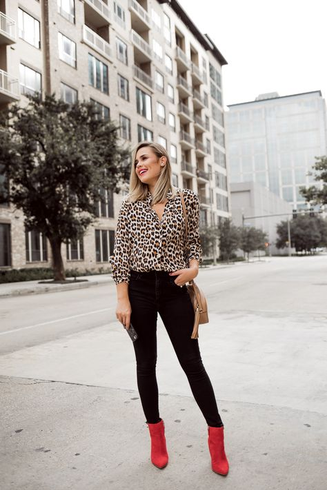 Houston fashion blogger Uptown with Elly Brown wears red ankle boots with a leopard top