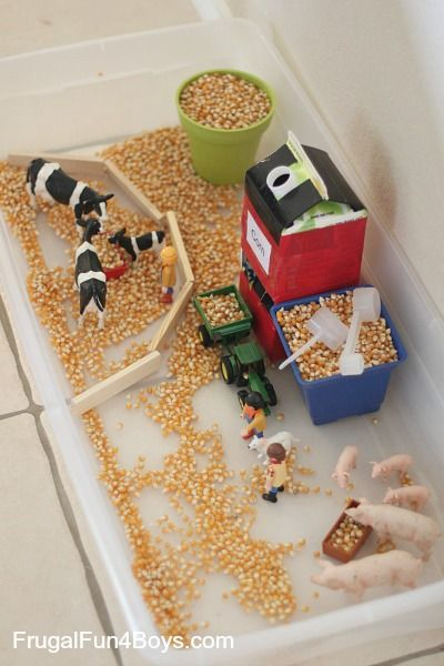 Farm Sensory Play for Preschoolers - An orange juice container makes a simple grain silo that really loads corn into a toy tractor! (preschool or kindergarten)