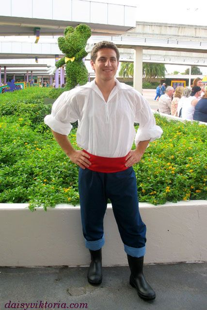 Prince Eric Costume from Little Mermaid all you need is a white shirt, red ribbon, workman's navy trousers and gum boots.