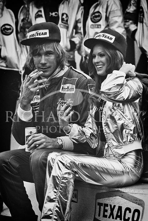 British 1976 World Champion James Hunt, a Schlitz and cigarette in hand and Penthouse Pet by his side, relaxes on his still warm Marlboro McLaren M26 after winning the 1977 United States Grand Prix at Watkins Glen.