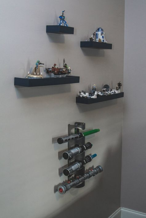 Our 7 year old asked for a Star Wars room for Christmas! Bedding from PBK, Lego shelves, a light saber holder (wine rack from IKEA) and some custom signs built and painted by me helped do the trick!  Facebook.com/OneGirlDesignShoppe