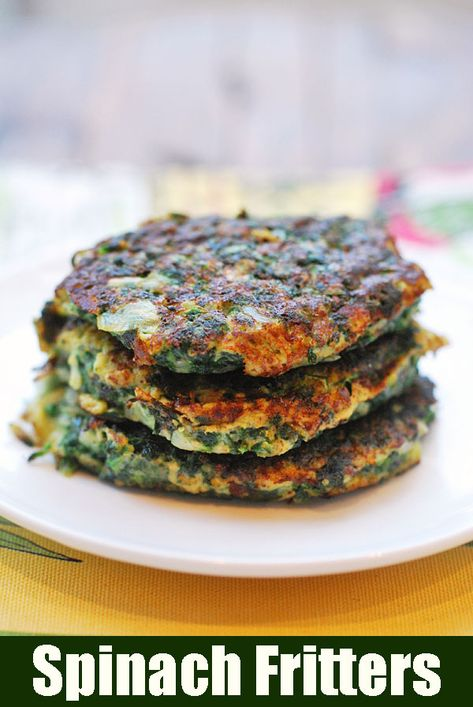 Crispy, golden keto spinach fritters turn the boring green vegetable into a delicacy. #keto #ketorecipes #lowcarb #lowcarbrecipes #glutenfree #glutenfreerecipes #healthyrecipes #spinach #fritters #vegetables