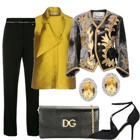 CERIMONIA IN VISTA I pantaloni neri Versace sono abbinati