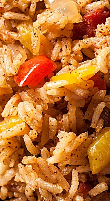 Slow Cooker Spanish Rice - make a double batch and use one for a side dish and freeze the other to combine with browned ground beef in stuffed cabbage rolls or stuffed peppers. You could even mix it to make porcupine meatballs! ❊