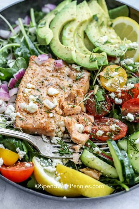 My family loves this fresh and simple salmon salad. Made with avocados, salmon, mixed greens and a light lemony dressing it is the perfect healthy summer recipe! #spendwithpennies #avocadosalmonsalad #salmonsalad #seafoodrecipe #healthy