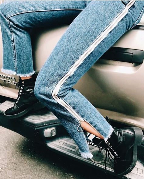 Denim jeans with cute side stripes and zippers.