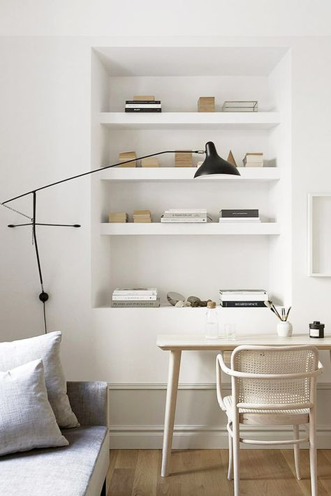 minimalist modern black and white desk area with built-in book shelves. / sfgirlbybay