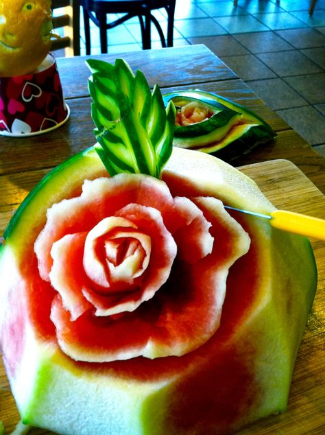 sometimes we need something to fit well in the middle of a tray, this chunk of watermelon is being carved to make a spectacular fruit tray look amazing!