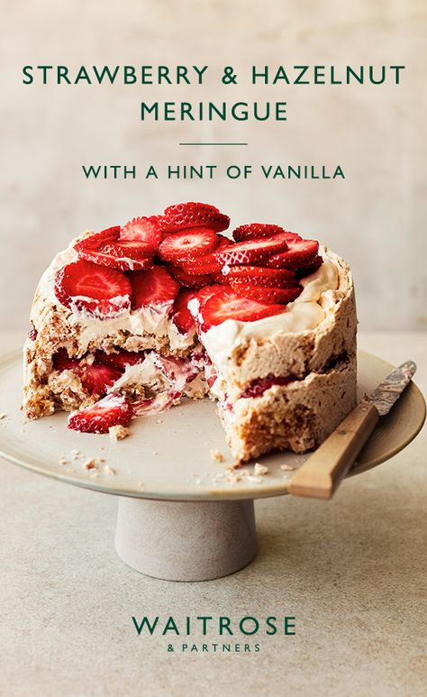 A British summer classic with a twist. Crisp hazelnut meringue, with a soft, chewy centre, topped with vanilla ceam and fresh strawberries.  Tap to see the full Waitrose  Partners recipe.
