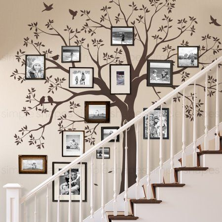 Our Family Tree Wall Decal provides a one-of-a-kind backdrop for your photo gallery wall inspiration. The Family Tree Decal is available in Chestnut Brown, Black, or any custom color from our color chart. Family Tree Mural, Tree Wall Murals, Family Wall Decor, Family Tree Paintings, Tree Artwork, Tree Wall Decor, Room Decor, Family Trees, Wall Decorations