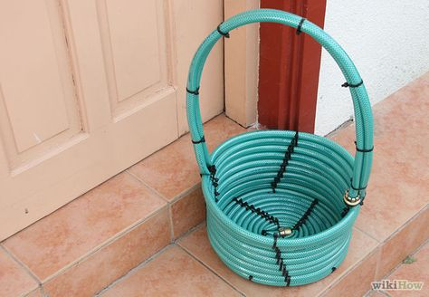 """How to Make a Basket from a Garden Hose. Create a unique and handy outdoor basket for your gardening tools or other small outdoor equipment using a regular garden hose. Identify where this outdoor """"basket"""" will be helpful. Fundraiser Baskets, Raffle Baskets, Themed Gift Baskets, Diy Gift Baskets, Theme Baskets, Picnic Baskets, Old Garden Tools, Gardening Tools, Gardening Vegetables"""