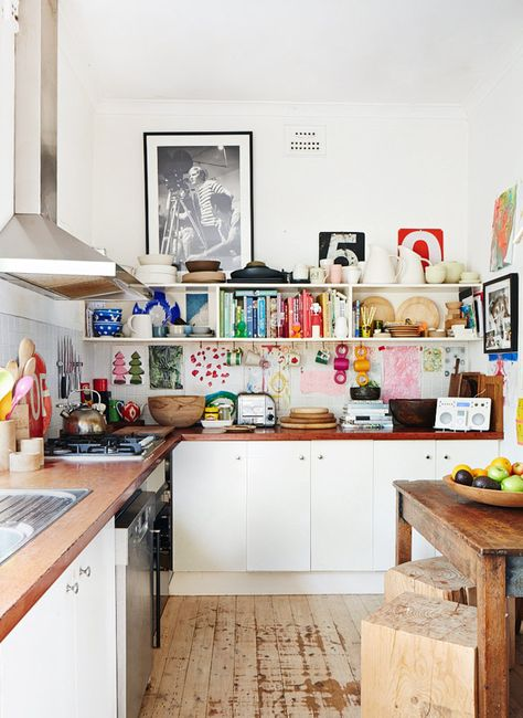 All the colour comes from the accessories and cookbooks to make this kitchen bright and colourful.