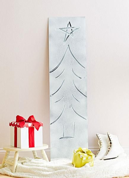 Cheap DIY Christmas Tree Decorations - mirror drawings with spray snow. More info: http://www.midwestliving.com/holidays/christmas/5-clever-and-cheap-diy-christmas-tree-alternatives/?page=3