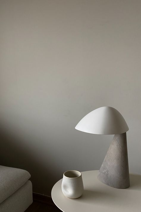 The Fellow Lamp designed by Space Copenhagen is made of Limestone and powder-coated metal. It can be adjusted to create different moods as part of the visual language, from curious when fully extended to shy when turned towards the base. Photo: Elisabeth Ønseth #fredericiafurniture #fellowlamp #spacecopenhagen #interiordesign #scandinaviandesign #tablelamp
