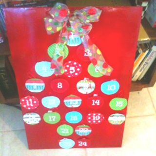 Advent calendar I made. Inside each ornament is the title of a Christmas book. We will read one each night together as a family!