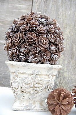 outdoor decor for winter - attach (hot glue won't last in cold weather) pinecones to large styrofoam shape of your choice, tip the ends with silver, white spray paint or fake snow, place in summer urn. Looks great indoors or outdoors.