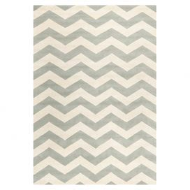 """Anchor your living room seating group or master suite ensemble with this hand-tufted wool rug, showcasing a chic chevron motif in gray and ivory.   Product: RugConstruction Material: 100% WoolColor: Gray and ivoryFeatures:  Hand-tuftedMade in IndiaCotton backing 0.5"""" Pile heightNote: Please be aware that actual colors may vary from those shown on your screen. Accent rugs may also not show the entire pattern that the corresponding area rugs have.Cleaning and Care: Rug pad recommended. ..."""