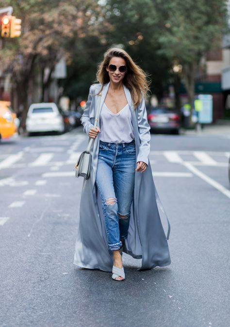 59b0a2dc NEW YORK, NY - SEPTEMBER 13: German fashion blogger and model Alexandra Lapp  (@alexandralapp_) grey silk trench coat from Galvan, Re Done Levis ripped  denim ...