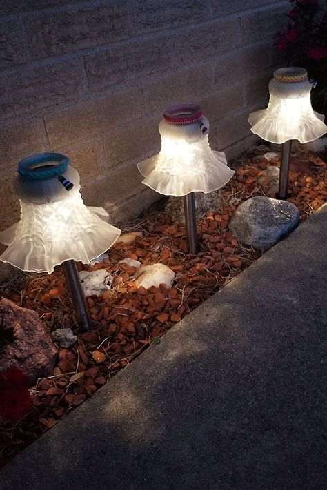 You can Create the Best Solar Garden Lights by following along with this easy instructional guide. If you love to repurpose, you will love this project because the lights are made with ceiling fan globes. Almost everyone has pitched an old ceiling fan. Now you can use some of that fan and recycle. #solarlight #garden #gardening #crafts #DIY #repurpose #lighting #inspireacreation.com