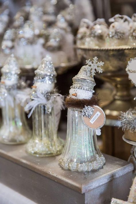 Learn how to create these gorgeous dollar store DIY Christmas table decorations for the festive season. You pick up all the supplies you need at your local dollar tree but you can also upcycle old salt and pepper shakers that you already have. These are seriously awesome holiday decorations on a budget you need to make!