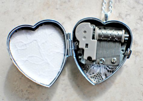 Silver Angel Wing Locket Music box locket, heart locket with music box inside, in silver tone with floral heart, angel wings and dragons breath opal cabochon. Cute Jewelry, Jewelry Box, Jewelry Accessories, Unique Jewelry, Danty Jewelry, Diamond Jewelry, Jewelry Necklaces, Accesorios Casual, Silver Lockets