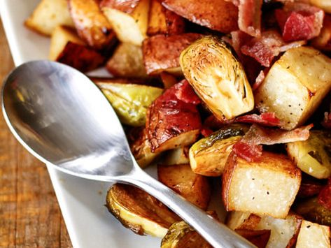 Roasted Potatoes with Brussels Sprouts and Bacon is perfect for your holiday table. With tender potatoes, crisp Brussels sprouts and savory bacon, this dish has something for everyone! #roastedpotatoes #potatoes #potatorecipe #brusselsprouts #brusselsproutrecipe #sidedish #easyroastedpotatoes #FavoriteFamilyRecipes #favfamilyrecipes #FavoriteRecipes #FamilyRecipes #recipes #recipe #food #cooking #HomeMade #RecipeIdeas