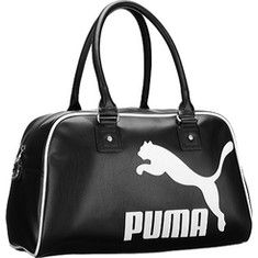 a1224a1771 This sporty bag from Puma features a top zip closure