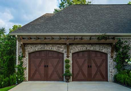 Wood Look Garage Doors Step Up Your Curb Appeal Game These Low Maintenance Steel And Composite Garage Best Garage Doors Garage Door Design Garage Door Styles