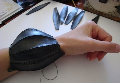 """Tassia Joannides - """"panel stitch bangle"""" using hand cut panels of bicycle inner tubes.  Tassia sees her practice as an investigation of form and how it can interact sensitively with the body, sometimes even as an extension of it. Typically she works with flexible materials which aid this special interaction and inspire her to push the boundaries of 3D soft structures."""
