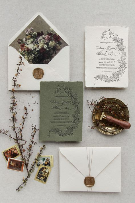 Letterpress invitation on ivory/green handmade paper with square white wax seal and flower liner