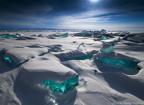 Lake Baikal, is the oldest freshwater lake on Earth. During the cold months of winter, the Siberian lake freezes over and a combination of wind, temperature differences, frost and sun cause the ice crust to crack and ice hummocks to form. These masses of broken ice are a gorgeous turquoise color. The icy blue blocks can reach as high as 50 feet. The lake is a natural wonder, over 25 million years old, and incredibly, one-fifth of the world's fresh water. photo: Alexey Trofimov