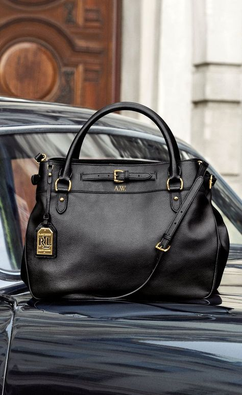 Crafted from smooth leather, this spacious Lauren Ralph Lauren satchel is designed with multiple zippered compartments, an adjustable shoulder strap that provides versatility and our signature monogram