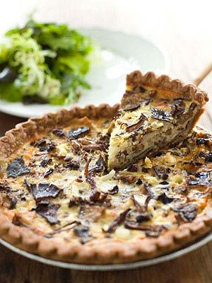 A robust mix of mushrooms serves as the filling for this rich quiche. Serve with a salad of seasonal greens.