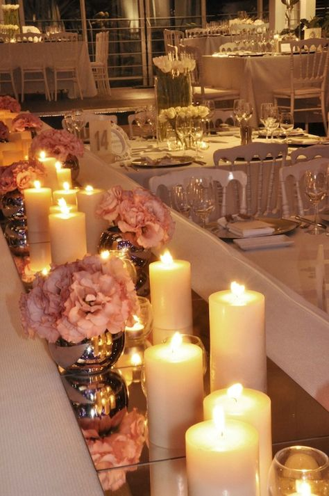 Mirror tiles as table runners. Beautiful with the candles to reflect their light