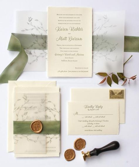 Deckled edge sage green and cream wedding invitation suite with leaf on vellum wrap finished with silk ribbon and copper wax seal. www.honey-paper.com