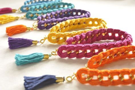 Throw in some arm party to your outfit! These crochet wrapped chain bracelets come in 6 yummy candy colors that are sure to add that pop of color. Each bracelet comes with a free charm tassel. The charm tassels are all detachable feel free to mix and mat Bracelet Crochet, Crochet Chain, Beaded Bracelets, Jewelry Crafts, Handmade Jewelry, Arm Party, Bijoux Diy, Schmuck Design, Crochet Accessories