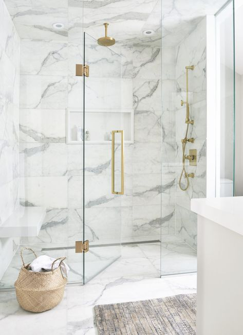gold Bathroom Decor Luxurious white and gray marble shower with a white niche enclosed with glass doors and brass hardware. Marble Tile Bathroom, White Marble Bathrooms, Marble Showers, Gold Bathroom, Master Bathroom, Tile Bathrooms, Bathroom Accents, Marble Tiles, Marble Floor