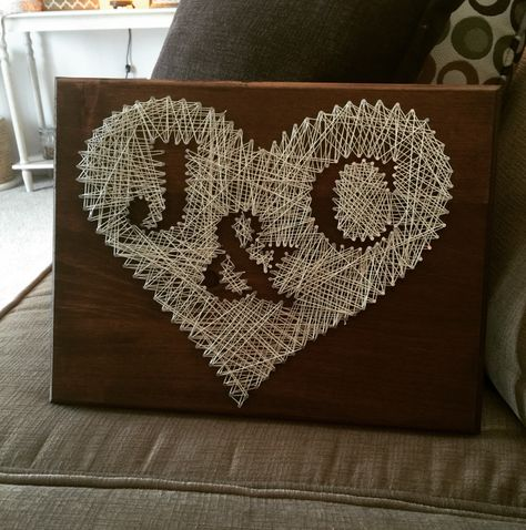String art with heart and couple's initials