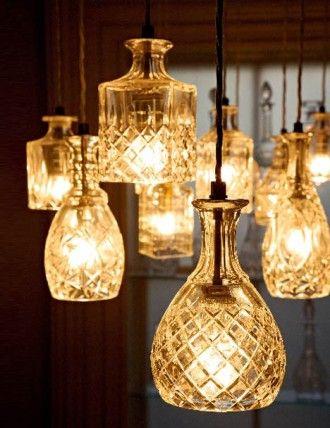 Glass decanters repurposed as lighting.