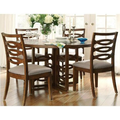 Claire De Lune Collection 5 piece Dining Set Includes Table and 4 Side Chairs. Understated sophistication characterizes the Claire De Lune Collection. Solid wood construction is accented by Cherry Veneers with Walnut Inlay.