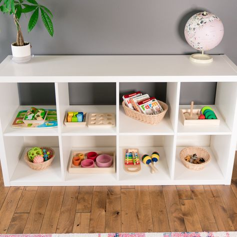This post talks about our Montessori shelves and how we set ours up. I go over what I've learned from others and include some pictures of our shelves. Montessori Toddler Rooms, Montessori Bedroom, Diy Montessori Toys, Montessori Color, Maria Montessori, Baby Playroom, Playroom Decor, Modern Playroom, Playroom Storage