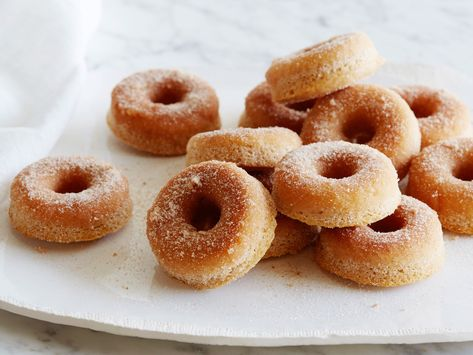 Recipe of the Day: Ina's Cinnamon Baked Doughnuts | Warm and crisp but never greasy, Ina's easy baked doughnuts have the same comforting flavor as a slice of cinnamon toast.