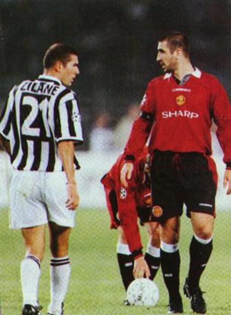 Face off: Zinedine Zidane and Eric Cantona go eyeball to eyeball.