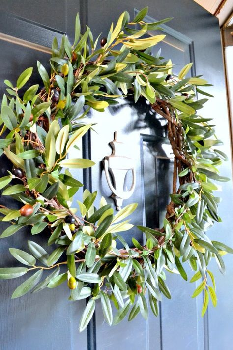 Front door fall wreath - this faux olive wreath is the perfect subtle nod to fall, never falls apart, and is great on the door for the start of my fall home tour! #autumn #falldecor #fallwreath #olivebranch #olivedecor #fallhometour #hometour #fallhome