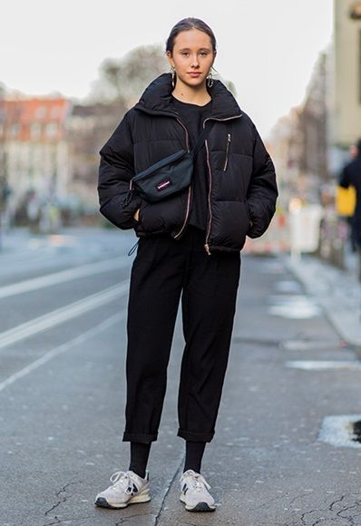 Street style girl wearing puffer jacket, bum bag and a pair of New Balance trainers ASOS Fashion & Beauty Feed