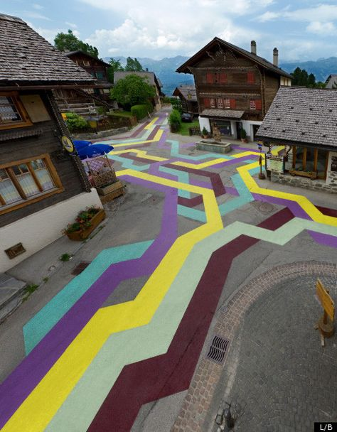An old Swiss village decided to use street art to spruce itself up. Every year the town challenges artists to create artworks which involve the entire city